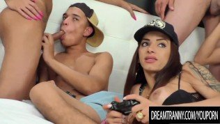 Wild Bareback Orgy with Three Hung Tgirls While Playing Video Games